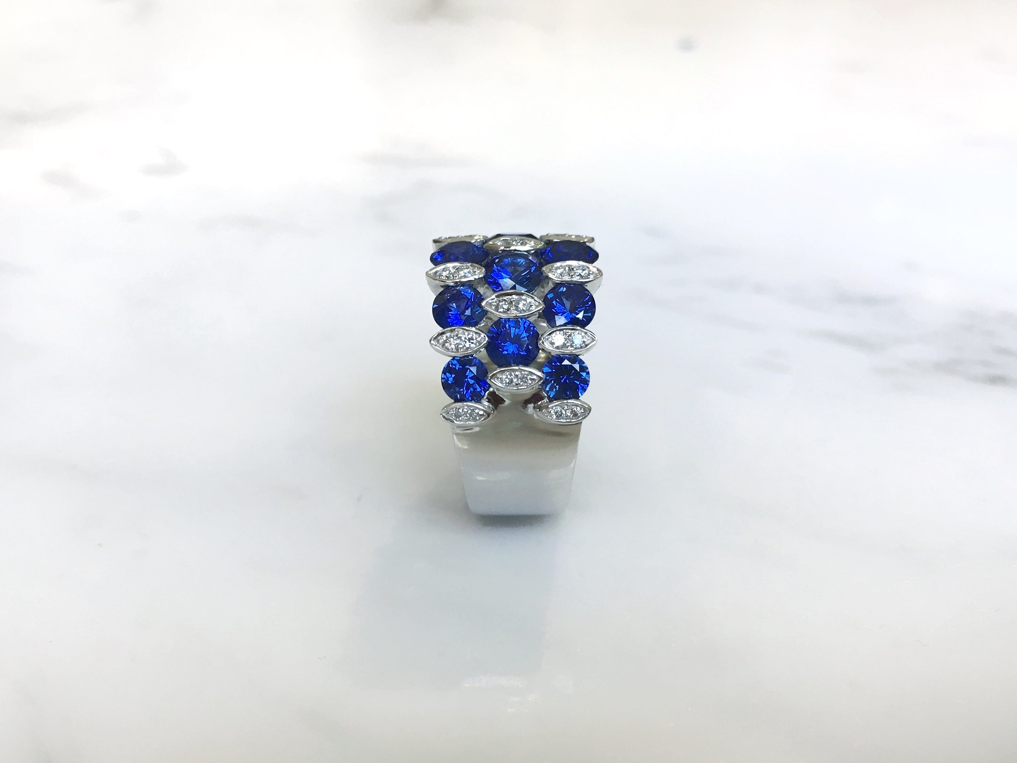 diamond charm and blue centres bands oval ring sapphire product