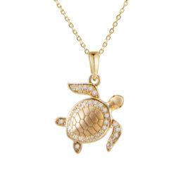14kt yellow gold .14ctw diamond turtle pendant