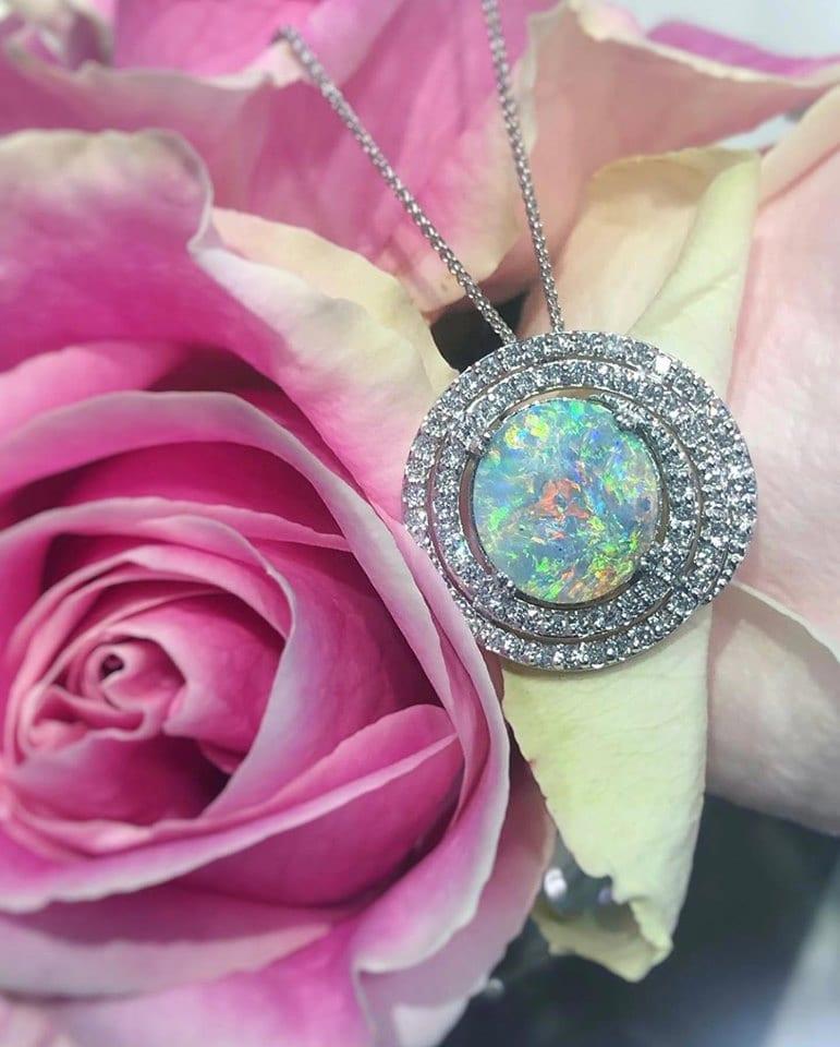 24182-14kt white gold black opal 5.08ct & diamond .86ctw pendant