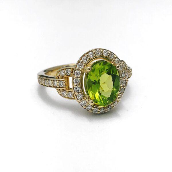 14kt yellow gold 1.72ct oval peridot & diamond halo .41ctw ring