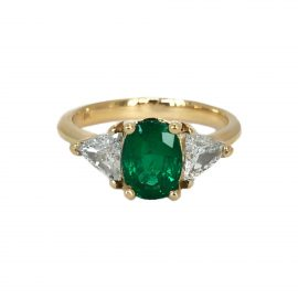 25898 - 18kt yellow gold oval emerald 1.33 ct & trillion shape diamond .56 ctw ring