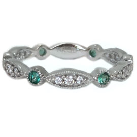 bezel set emerald alt with diamonds set in marquise shape