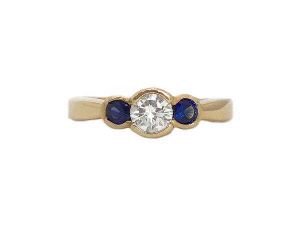 round diamond .52 carat and sapphires three stone ring