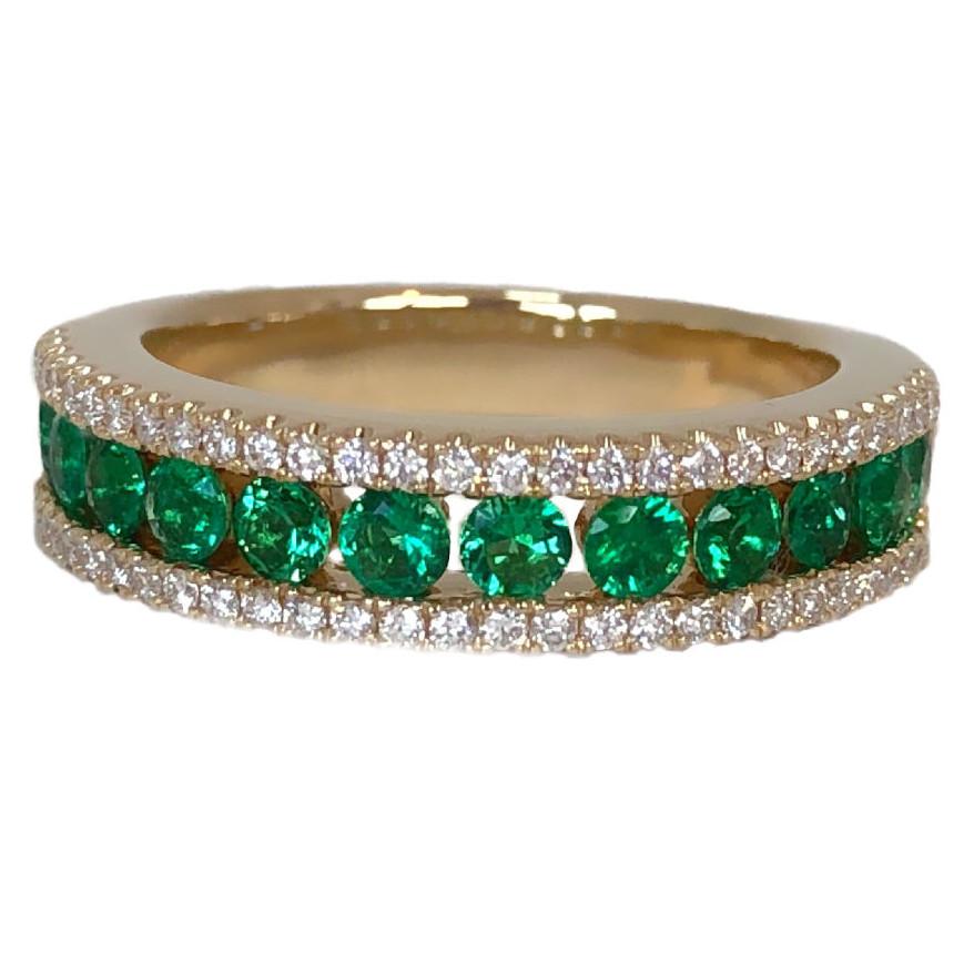 emerald .84 carats and diamond three row band