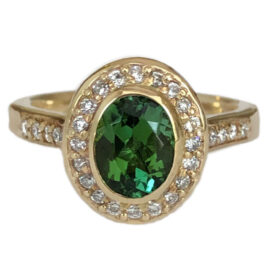 oval green tourmaline ring 1.34 carat bezel set with diamond halo